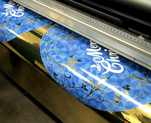 Printing Christmas decorations onto gold foil adhesive vinyl